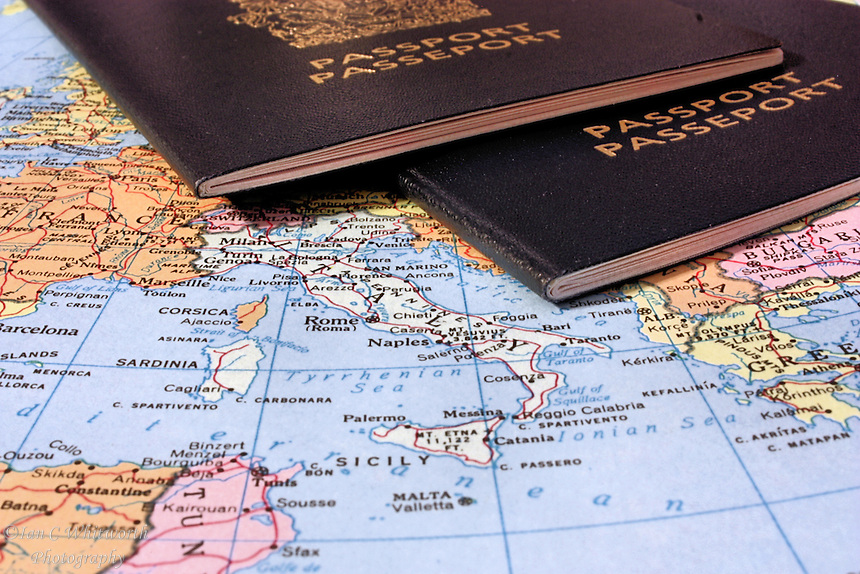 Map of Italy with two passports in preparation for a trip