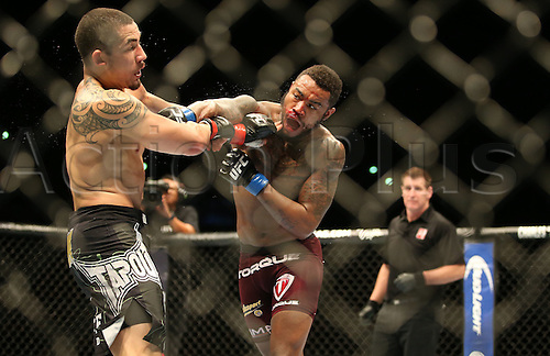 28.06.2014 Auckland, New Zealand. UFC Fight Night. Robert Whittaker,left,  from NZ beats Mike Rhodes from the USA during the UFC Ultimate Fighting Championship fight night held at Vector Arena