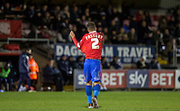 Josh Passley of Dagenham & redbridge removes his top as he walks to the tunnel after receiving a straight red card during the Sky Bet League 2 match between Dagenham and Redbridge and Wycombe Wanderers at the London Borough of Barking and Dagenham Stadium, London, England on 9 February 2016. Photo by Andy Rowland.