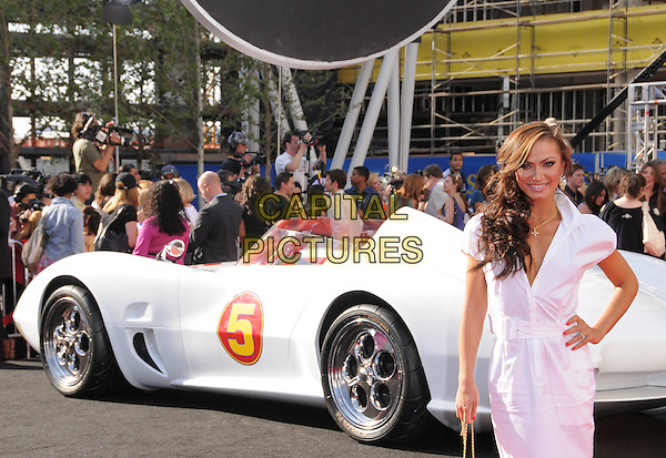 """KARINA SMIRNOFF.Attending The Warner Brothers Pictures World Premiere of """"Speed Racer"""" held at The Nokia Theatre in Los Angeles, California, USA, April 26th 2008.                                                                     .half length car white shirt dress hand on hip.CAP/DVS.©Debbie VanStory/Capital Pictures"""