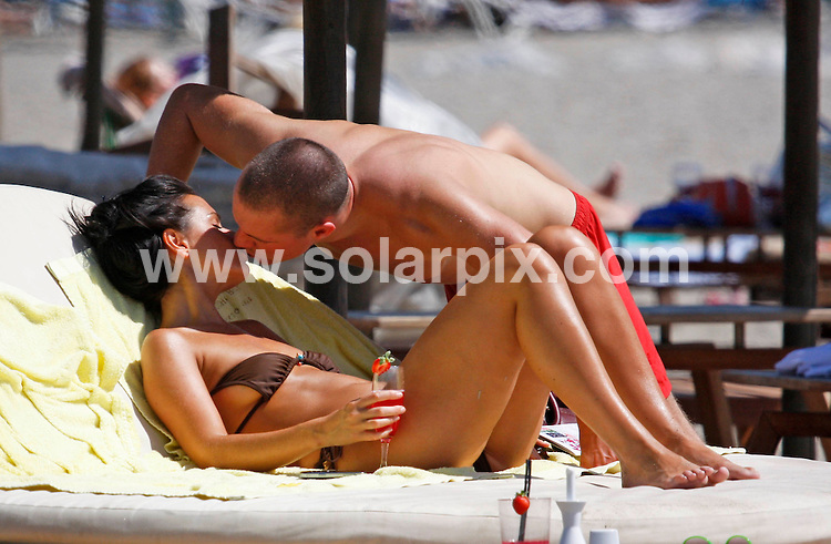 """**ALL-ROUND EXCLUSIVE PICTURES FROM SOLARPIX.COM**.**WORLDWIDE SYNDICATION RIGHTS**.Jennifer Metcalfe, who plays McQueen sister Mercedes Fisher in Hollyoaks, shows off her new boyfriend, William Rodgers on a romantic weekend break in Marbella, Spain. The couple laughed and joked as they relaxed on a sun bed by the sea looking very much in love..An onlooker said they looked absolutely besotted with each other..When asked, Jennifer said: """"It's early days but yes, I do have a new bloke. He's lovely and is making me very happy, but it's very casual at the moment. He's not famous, he's an ordinary man."""".Jennifer - who has previously dated soccer star Jermaine Pennant and former 'Big Brother' contestant Ziggy Lichman, insists she prefers dating men who are out of the spotlight..She added: """"I don't see men as celebs and non-celebs but it's easier to be with someone if they're not in the public eye, as you can escape it."""".JOB REF:    9978   AB1       DATE:  20.09.09.**MUST CREDIT SOLARPIX.COM OR DOUBLE FEE WILL BE CHARGED**.**MUST AGREE FEE BEFORE ONLINE USAGE**.**CALL US ON: +34 952 811 768 or LOW RATE FROM UK 0844 617 7637**"""