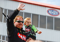 May 15, 2016; Commerce, GA, USA; NHRA top fuel driver Terry McMillen with son Cameron McMillen during the Southern Nationals at Atlanta Dragway. Mandatory Credit: Mark J. Rebilas-USA TODAY Sports