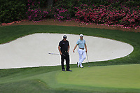 Phil Mickelson (USA) and Justin Thomas (USA) on the 13th green during the final round at the The Masters , Augusta National, Augusta, Georgia, USA. 14/04/2019.<br /> Picture Fran Caffrey / Golffile.ie<br /> <br /> All photo usage must carry mandatory copyright credit (© Golffile | Fran Caffrey)