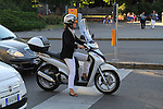Woman on Vespa motor scooter in downtown Milan, Italy. .  John offers private photo tours in Denver, Boulder and throughout Colorado, USA.  Year-round. .  John offers private photo tours in Denver, Boulder and throughout Colorado. Year-round.