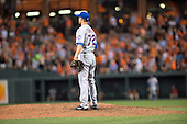 New York Mets relief pitcher Carlos Torres (72) watches the flight of the ball off the bat of Baltimore Orioles left fielder Henry Urrutia (51) in the ninth inning against the Baltimore Orioles at Oriole Park at Camden Yards in Baltimore, Maryland on Wednesday, August 19, 2015.  The walk-off home run gave the Orioles a 5 - 4 victory.<br /> Credit: Ron Sachs / CNP<br /> (RESTRICTION: NO New York or New Jersey Newspapers or newspapers within a 75 mile radius of New York City)