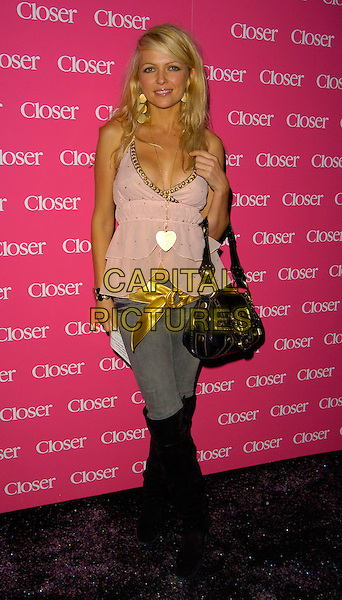 HANNAH SANDLING .The Closer Magazine 4th Anniversary party, Pangaea nightclub, Ldonon, UK..September 25th, 2006.Ref: CAN.full length jeans denim tucked into black boots yellow ribbon belt heart necklace.www.capitalpictures.com.sales@capitalpictures.com.©Can Nguyen/Capital Pictures