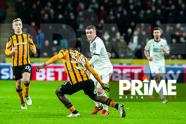 Sheffield United's midfielder John Fleck (4) is blocked bu Hull City's defender Ola Aina (34)  during the Sky Bet Championship match between Hull City and Sheff United at the KC Stadium, Kingston upon Hull, England on 23 February 2018. Photo by Stephen Buckley / PRiME Media Images.