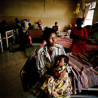17 year old Anna Nicole and her seven month old baby Musafee born as a result of her rape, in hospital in Goma. An estimated 250,000 women have been victims of sexual violence during the Democratic Republic of Congo's civil war. In the eastern states of the country a recent peace agreement struggles to keep warring factions from fighting, and as the chaos that accompanies war continues, so does the rape of women in the area..©Robin Hammond/PANOS/Felix Features