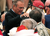 Coronado, Calif. (Aug. 30, 2005) - Secretary of Defense Donald Rumsfeld greats World War II veterans prior to a speech from President George W. Bush on board Naval Air Station (NAS) North Island. President Bush visited NAS North Island to commemorate the 60th anniversary of the allied forces victory over Japan (VJ Day) during World War II. <br /> Mandatory Credit: Aaron Burden / US Navy via CNP