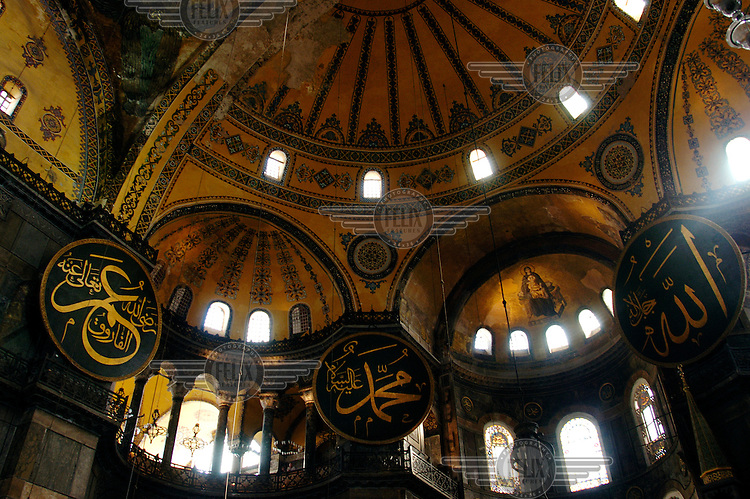 Interior of Aya Sophia, with giant medallions displaying Arabic calligraphy dating from the period when Aya Sophia was a mosque. This former church was first completed in 537.