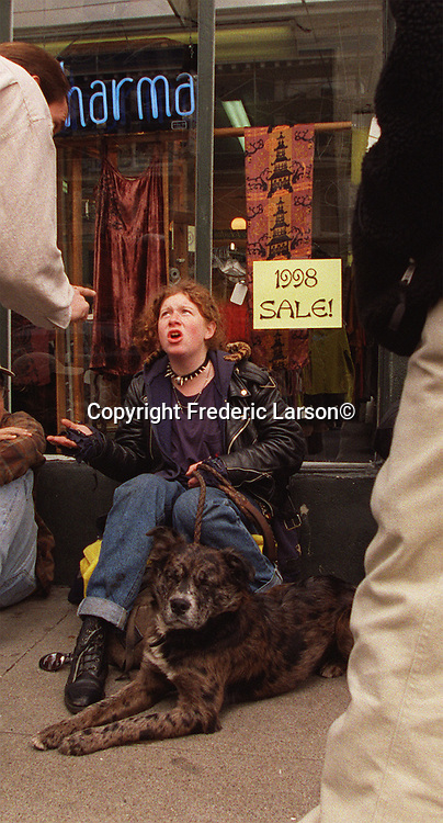 Shera, age 17, has a verbal fight with a shopkeepers who objected to her and friends blocking the sidewalk preventing access down Haight Street In San Francisco, California.
