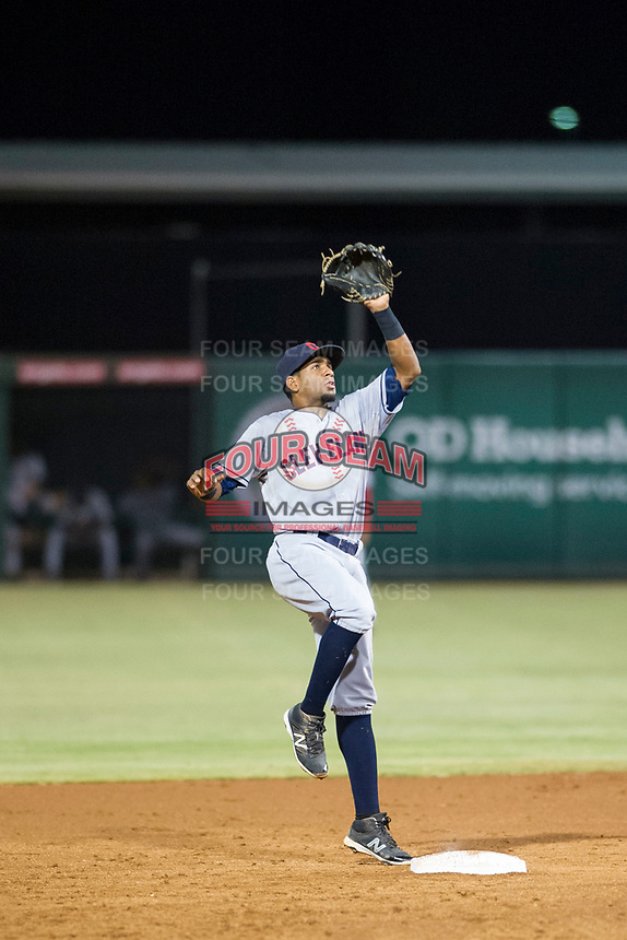 AZL Indians second baseman Jhan Rodriguez (4) leaps for a throw from catcher Angel Lopez Alvarez (not pictured) between innings during a game against the AZL Angels on August 7, 2017 at Tempe Diablo Stadium in Tempe, Arizona. AZL Indians defeated the AZL Angels 5-3. (Zachary Lucy/Four Seam Images)