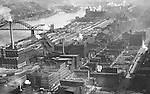 Pittsburgh PA:  View of the Strip District Railroad yards, 16th Street Bridge, and Strip District businesses taken from the new Kopper's Building. A few notable companies in the strip at that time were; Byrnes & Kiefer Company, Frick Refrigeration, Gloekler Refrigeration Company, Hardestry and Stineman Bankers Supplies, James W Houston Company, Marietta Chair Company, and Oil Well Supply Company.
