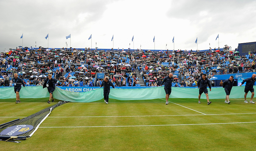 Covers on the court for the second time with Andy Murray (GBR) and Viktor Troicki (SRB) 3-3 in the first set<br /> <br /> <br /> <br /> Photographer Ashley Western/CameraSport<br /> <br /> Tennis - ATP 500 World Tour - AEGON Championships- Day 6 - Saturday 20th June 2015 - Queen's Club - London <br /> <br /> &copy; CameraSport - 43 Linden Ave. Countesthorpe. Leicester. England. LE8 5PG - Tel: +44 (0) 116 277 4147 - admin@camerasport.com - www.camerasport.com