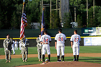 Tri-City ValleyCats starting pitcher Mark Appel #28 stands with teammates Adam Nelubowich #24 and Conrad Gregor #27 during the national anthem before his first professional start against the Lowell Spinners on July 5, 2013 at Joseph L. Bruno Stadium in Troy, New York.  Appel was the first overall selection of the 2013 Major League Baseball Draft by the Houston Astros out of Stanford University.  (Mike Janes/Four Seam Images)