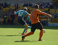Pictured: Saturday 30 July 2016<br /> Re: Wolverhampton Wanderers v Swansea City FC, pre-season friendly at the Molineux Stadium, England, UK<br /> Swan's Oliver McBurnie slots home the fourth goal