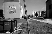 Tychy, Poland.August 1997.Happy people pulling up to a McDrive in an ad pasted on the empty wall of an old Soviet housing structure. The worst of the East and the worst of the West meet here and create an unpleasant image..