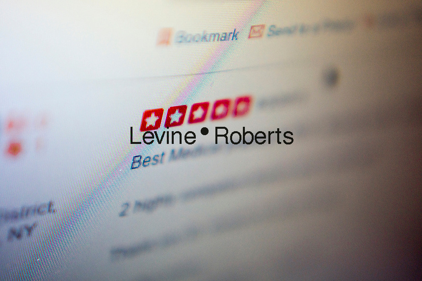 A five-star review is seen on the Yelp website on a computer in New York on Monday, September 23, 2013.  The NYS Attorney General has announced a crackdown on deceptive reviews, notably companies that create  fake reviews and their clients. (© Richard B. Levine)
