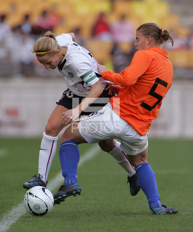 Nov 2, 2006: Suwon, South Korea:  USWNT forward (13) Kristine Lilly has the ball tackled away from her by Netherlands defender (5) Petra Hogewonig during the Peace Queen Cup at Suwon World Cup Stadium. The US defeated the Netherlands, 2-0.