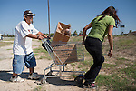 Benny Lopez, left, and Marivel Flores, right, walk home with food they received at a food distribution center in Crystal City, Texas. The San Antonio Food Bank makes monthly deliveries to Crystal City in Zavala County, Texas, which has the nation's highest rate of food insecurity. October 2, 2012. Copyright Lance Rosenfield / Prime