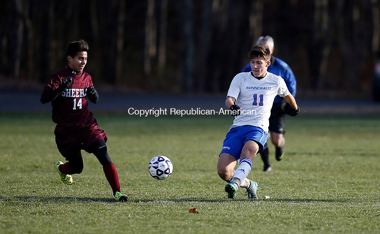 Woodbury, CT- 14 November 2015-111415CM07-  Nonnewaug's Jake Peters, right, moves in for the ball against  Sheehan's Kevin Morales during their state tournament matchup in Woodbury on Saturday. Nonnewaug would go onto win, 1-0 advancing to the Class M semi-finals.   Christopher Massa Republican-American