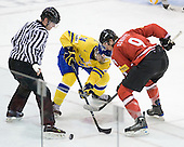 Marcus Kruger (Sweden - 24), Reto Schappi (Switzerland - 9) - Sweden defeated Switzerland 11-4 to win the Bronze on Tuesday, January 5, 2010, in the 2010 World Junior championship at Credit Union Centre in Saskatoon, Saskatchewan.
