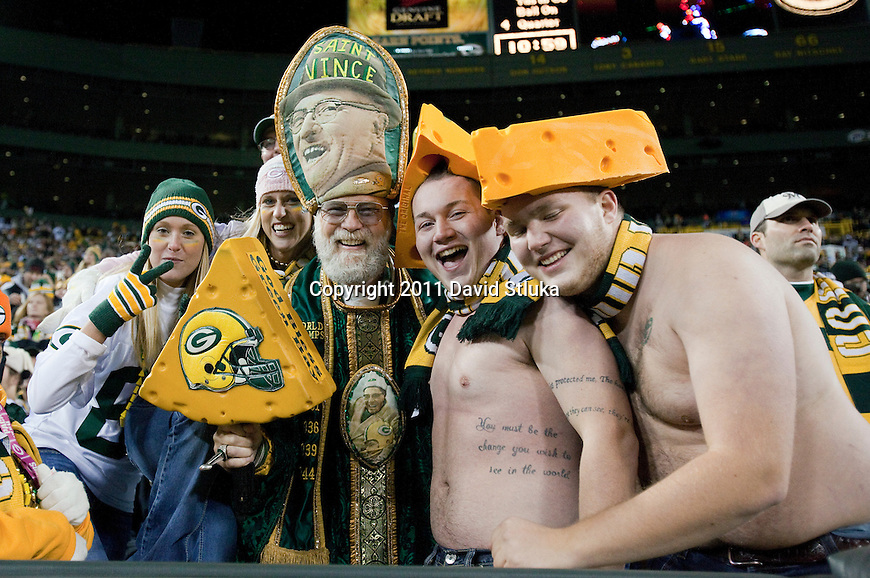 Green Bay Packer fans pose for the camera during a Week 10 NFL Monday Night Football game against the Minnesota Vikings on November 14, 2011 in Green Bay, Wisconsin. The Packers won 45-7. (AP Photo/David Stluka)