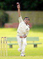 Prashanth Patel bowls for Harrow Town during the ECB Middlesex Division Three game between Highgate and Harrow Town at Park Road, Crouch End on Saturday May 24, 2014