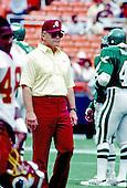 Washington Redskins head coach Joe Gibbs watches his team warm-up prior to the game against the Philadelphia Eagles at RFK Stadium in Washington, DC on September 8, 1986.<br /> Credit: Arnie Sachs / CNP