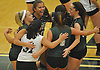 Seaford No. 16 Sophie Dandola, top left, and teammates celebrate as they close in on a hard-fought second set win over Lynbrook in the Nassau County varsity girls' volleyball Class B final at SUNY Old Westbury on Wednesday, Nov. 11, 2015. Seaford won 25-18, 26-24, 25-20 to claim the county championship.<br /> <br /> James Escher