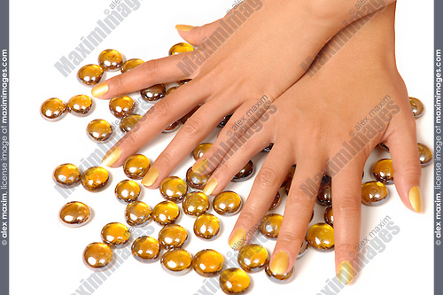Female hands with golden manicure in golden glass stones on white background  Beauty treatment makeup manicure concept