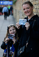 Happy fans show off their tickets to this ticket only match prior to the Sky Bet League 1 match between AFC Wimbledon and MK Dons at the Cherry Red Records Stadium, Kingston, England on 22 September 2017. Photo by Carlton Myrie / PRiME Media Images.