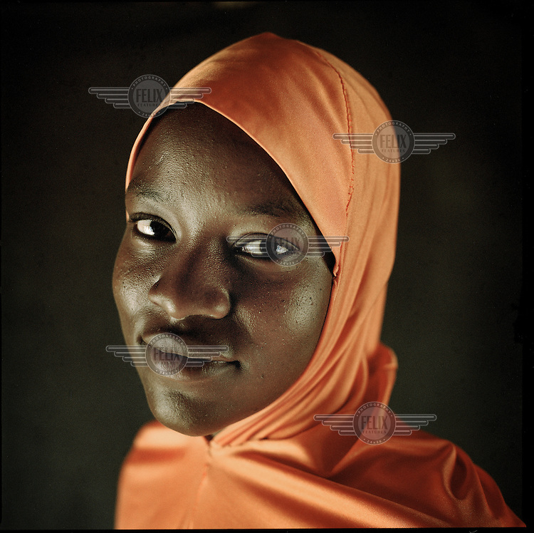 Since the start of Boko Haram's insurgency thousands of boys and girls have gone missing across north eastern Nigeria. The Islamist group use the kidnap of children as a strategy in their asymmetric war. Girls, as young as eight, are taken to be married off to fighters or deployed as sex slaves and, increasingly, used to commit suicide attacks. <br /> <br /> Lucy (22): &lsquo;The insurgents came to my village around 4 pm. They shot at anything that moved and bombs were going off everywhere. I hid in our house. Three days after the violence got worse. Men were dragged out of their houses and older women were shot without any reason. I was captured and locked up with the other girls from the village. I was imprisoned for two months. Sometimes one of my friends would be married off and I never saw them again. I managed to escape but each day I still think about the girls who were less fortunate.