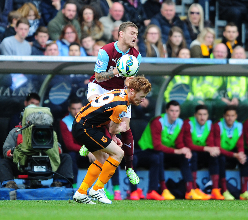 Burnley's Kieran Trippier is fouled by Hull City's Stephen Quinn<br /> <br /> Photographer: Chris Vaughan/CameraSport<br /> <br /> Football - Barclays Premiership - Hull City v Burnley - Saturday 9th May 2015 - Kingston Communications Stadium - Hull<br /> <br /> &copy; CameraSport - 43 Linden Ave. Countesthorpe. Leicester. England. LE8 5PG - Tel: +44 (0) 116 277 4147 - admin@camerasport.com - www.camerasport.com