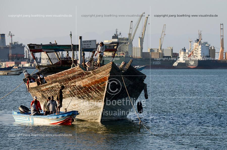 DJIBOUTI, port, wooden dhow infront of container port, most of the goods for or from Ethiopia are shipped via Djibouti / DSCHIBUTI Hafen, Dhau vor Containerhafen, die meisten Waren fuer und von Aethiopien werden ueber Djibouti verschifft