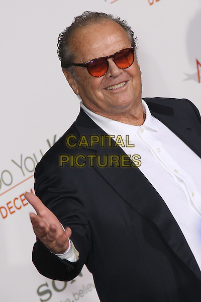 JACK NICHOLSON.World Premiere of 'How Do You Know' at the Mann Village Theatre, Westwood. Los Angeles, CA, USA, .December 13th, 2010. .half length hand sunglasses smiling white shirt red tinted glasses lenses .CAP/CEL.©CelPh/Capital Pictures.