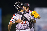 Kannapolis Intimidators relief pitcher Mike Morrison (24) gets a hugs from catcher Seby Zavala (21) after closing out the win over the Hickory Crawdads in game two of a double-header at Kannapolis Intimidators Stadium on May 19, 2017 in Kannapolis, North Carolina.  The Intimidators defeated the Crawdads 9-1.  (Brian Westerholt/Four Seam Images)