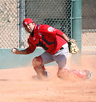 Carlos Ramirez #69 of the Los Angeles Angels participates in catchers fielding drills during spring training workouts at the Angels complex on February 22, 2011  in Tempe, Arizona. .Photo by:  Bill Mitchell/Four Seam Images.