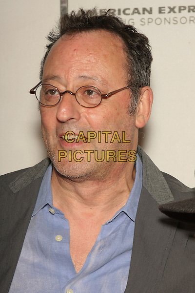 "JEAN RENO .attending the 2010 Tribeca Film Festival Premiere of ""My Own Love Song"" held at the Tribeca Performing Arts Center, New York, NY, USA,  22nd April 2010..portrait headshot blue shirt glasses grey gray                                        .CAP/LNC/TOM.©LNC/Capital Pictures."