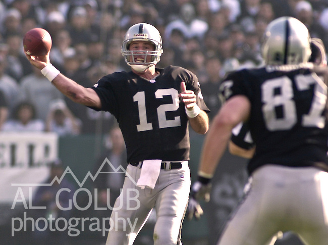 Oakland Raiders vs. Miami Dolphins at Oakland Alameda County Coliseum Saturday, January 6, 2001.  Raiders beat Dolphins  27-0.  Oakland Raiders quarterback Rich Gannon (12) passes to tight end Jeremy Brigham (87).