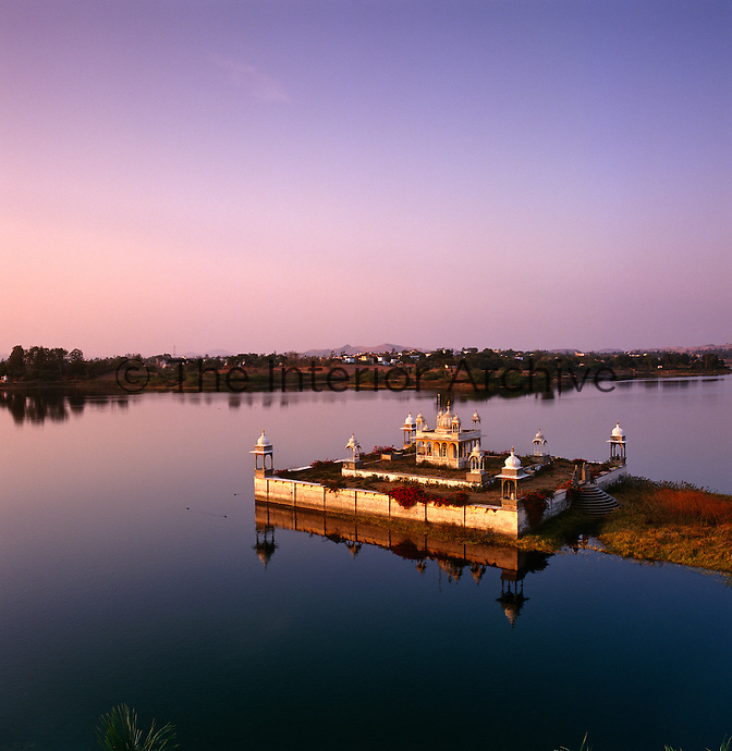 The classical Rajasthan architecture of this cistern is reflected in the tranquil water of the lake