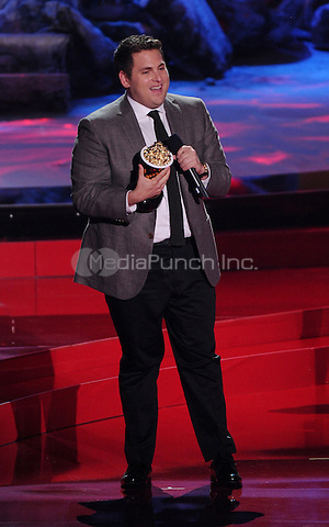 LOS ANGELES, CA - APRIL 13: Jonah Hill accepts the award for Best Comedic Performance onstage at the 2014 MTV Movie Awards at Nokia Theatre L.A. Live on April 13, 2014 in Los Angeles, California. Credit: MPIMIcelotta/MediaPunch