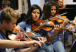 The McQueen High School orchestria performs at the Legislative Building in Carson City, Nev., on Wednesday, April 22, 2015. <br /> Photo by Cathleen Allison