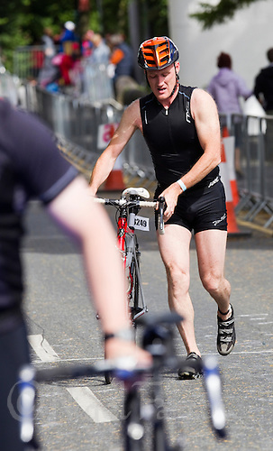 03 JUL 2010 - ATHLONE, IRL - A competitor runs to transition after dismounting during the Citizens Race at the European Triathlon Championships (PHOTO (C) NIGEL FARROW)