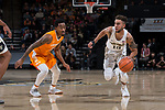 Mitchell Wilbekin (10) of the Wake Forest Demon Deacons dribbles the ball past Jordan Bowden (23) of the Tennessee Volunteers during first half action at the LJVM Coliseum on December 23, 2017 in Winston-Salem, North Carolina.  The Volunteers defeated the Demon Deacons 79-60.  (Brian Westerholt/Sports On Film)