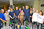 Mikey Sheehy and Kieran Donaghy along with Cork Hurler Sean Og O'Halpin with Staff and customers of Ulster Bank in Ashe Street on Friday pictured at the virtual cycle from Kerry to Donegal who undertook the 360 Kilometers distance from Kerry to Donegal on stationary bikes.