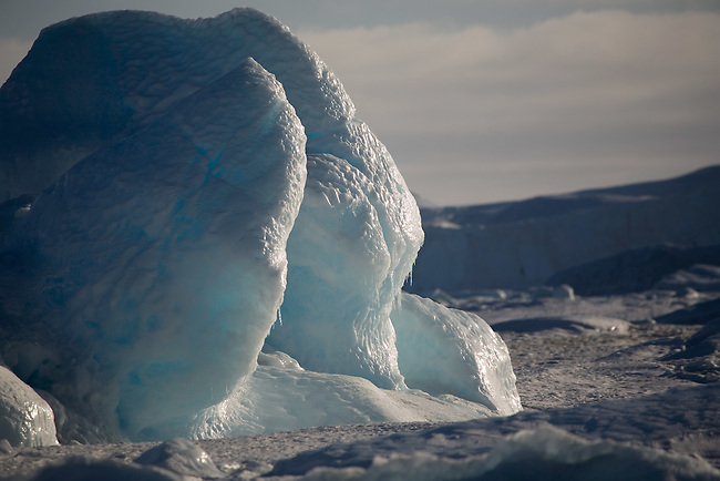 Very eroded remains of an iceberg frozen into the sea ice. Antarctica