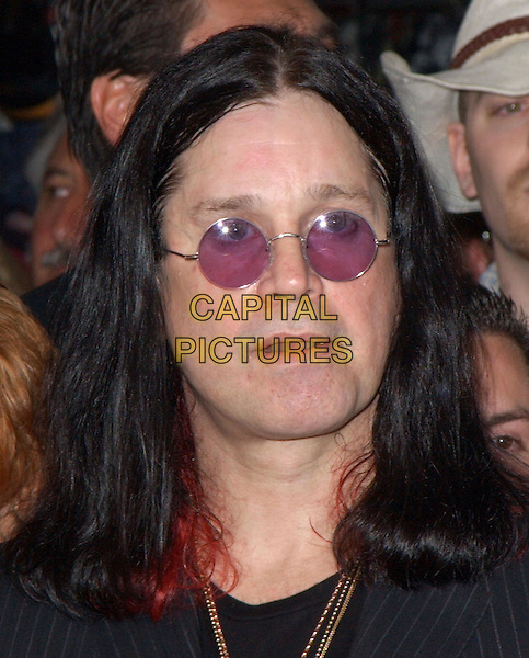 OZZY OSBOURNE.attends the ceremony to posthumously induct Randy Rhoads into the Hollywood Rockwalk in Hollywood, California .18 March 2004.*UK Sales Only*.headshot, portrait, sunglasses, shades.www.capitalpictures.com.sales@capitalpictures.com.©Capital Pictures.