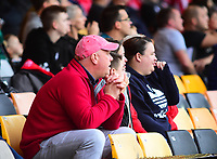 Lincoln City fans watch their team in action<br /> <br /> Photographer Andrew Vaughan/CameraSport<br /> <br /> The EFL Sky Bet League Two - Port Vale v Lincoln City - Saturday 13th October 2018 - Vale Park - Burslem<br /> <br /> World Copyright © 2018 CameraSport. All rights reserved. 43 Linden Ave. Countesthorpe. Leicester. England. LE8 5PG - Tel: +44 (0) 116 277 4147 - admin@camerasport.com - www.camerasport.com