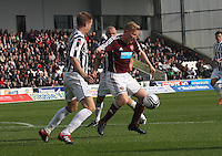 Andrew Driver being closely marked by Marc McAusland in the St Mirren v Heart of Midlothian Clydesdale Bank Scottish Premier League match played at St Mirren Park, Paisley on 15.9.12.